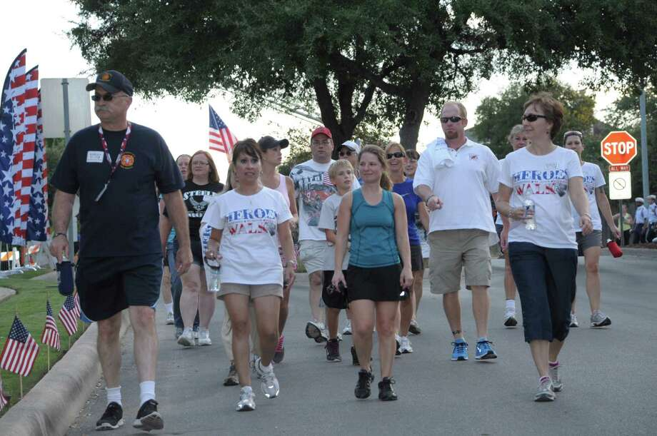Participants in the fourth annual Heroes Walk begin their 1.3-mile journey from the Olympia Hills Golf and Conference Center on Sept. 11, the 11th anniversary of the terrorist attacks in New York and Washington, D.C. Photo: Marty Waddy