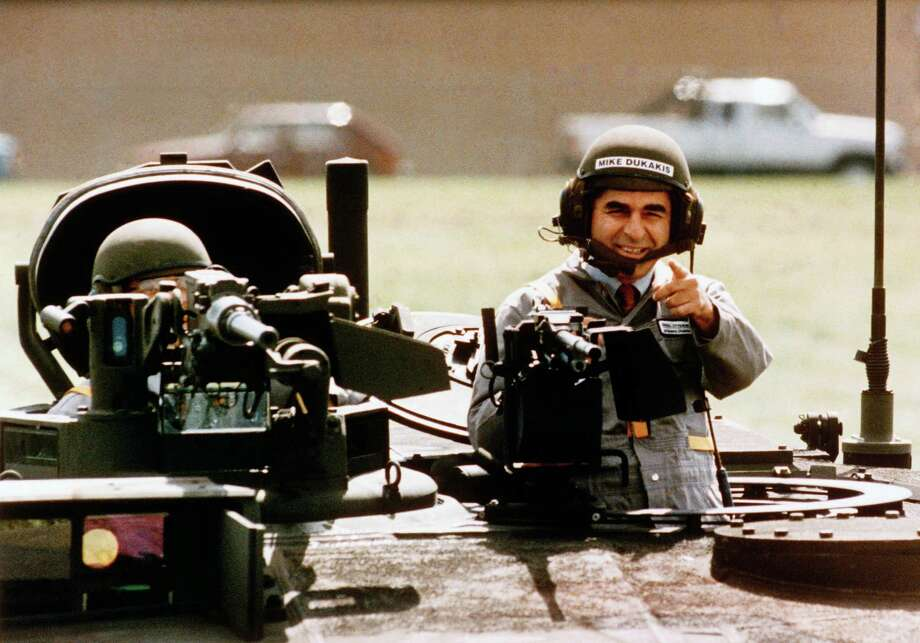 In this Sept. 13, 1988, file photo Democratic presidential candidate Michael Dukakis gets a free ride in a new M1-A-1 battle tank during a visit to General Dynamics in Sterling Heights, Mi., where he told workers he's not soft on defense. The image of a helmeted Dukakis taking a spin in a tank proved to be the ultimate in What Not To Wear for a presidential candidate during his run, his loosing run, for the presidency against President George H.W. Bush. Photo: AP