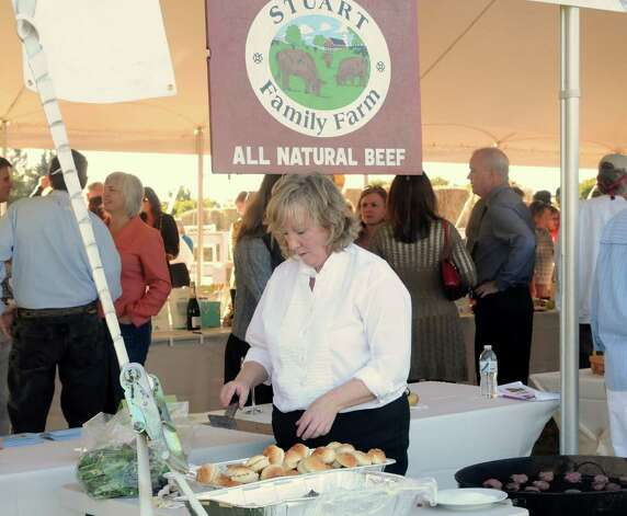Jean Jackson serves 100 percent grass-fed beef sliders at the Bridgewater Land Trust's farm to fork (plow to plate) dinner in Bridgewater on Saturday, September 15, 2012. Photo: Lisa Weir