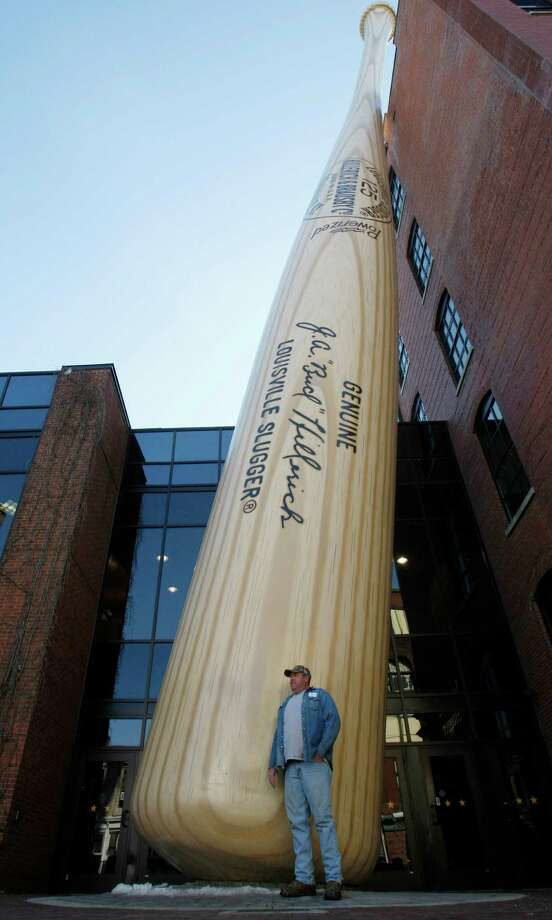 In this Friday, Feb. 19, 2010, photo Bland McCall of Bennettsville, S.C., poses in front of the iconic Louisville Slugger bat at the Louisville Slugger Museum & Factory in Louisville, Ky. Photo: Ed Reinke, AP / AP
