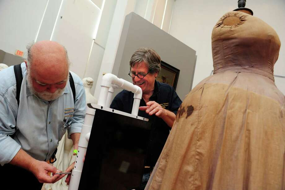 Quinnipiac University professors, Gerald Conlogue, left, and Ronald Beckett, set up to take an x-ray of Lavinia Warren's dress form Tuesday, Sept. 18, 2012 at the Barnum Museum in Bridgeport.  Their examination of the museum's artifacts will uncover any damage from the 2010 tornado that shattered two of the museum's windows. Photo: Autumn Driscoll / Connecticut Post