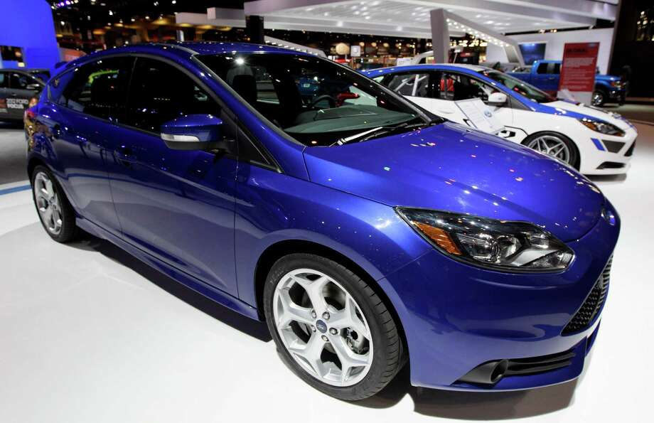 In this Feb. 8, 2012 file photo, Ford introduces a 2013 Ford Focus ST during the media preview of the Chicago Auto Show at McCormick Place in Chicago. (AP photo/Nam Y. Huh, File) Photo: Nam Y. Huh, Associated Press / AP