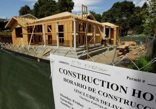 A new home under construction in Palo Alto, Calif.  For the first time since the recession, there's potential for rising U.S. property values to boost consumer spending and give the economy a nudge, according to some economists. Photo: Paul Sakuma, Associated Press / AP