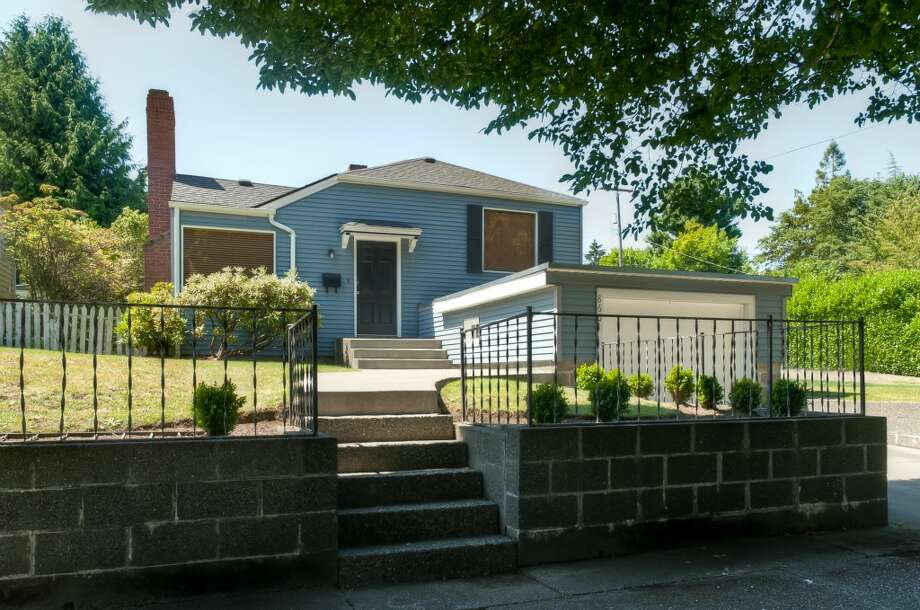 The Fauntleroy neighborhood offers convenient access to the best of West Seattle, with reasonably priced homes. Here are three early 1940s homes listed there for less than $350,000, starting with 8601 35th Ave. S.W. The 1,250-square-foot home, built in 1942, has two bedrooms, two bathrooms, a basement bonus room and a patio with a fire pit on a 6,410-square-foot lot. It's listed for $310,700. Photo: Keith Cottrill, Courtesy Jarred Hoffpauir/John L. Scott Real Estate