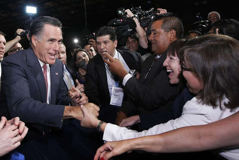 Mitt Romney greets Latino officials at a conference in June - before his standing with Hispanics nose-dived. Photo: Charles Dharapak, Associated Press
