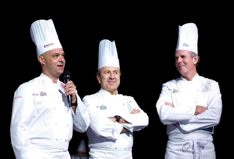 Chefs Jérôme Bocuse, from left, Daniel Boulud and Thomas Keller, will be participating in the World Master Chefs Dinner fundraiser on Sept. 29. , 2012, a fundraiser for the Harris Country Sheriff's Office Foundation. Photo: Bocuse D'Or Foundation / Bonjwing Lee