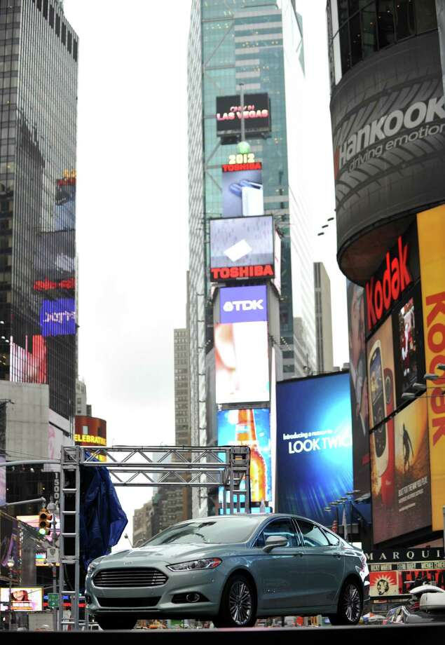 The 2013 Ford Fusion Hybrid was introduced Tuesday in New York's Times Square. Photo: STAN HONDA / AFP
