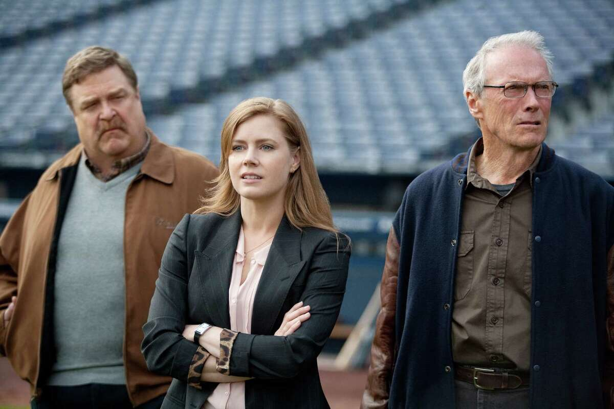 John Goodman, left, stars as Pete Klein, Amy Adams, center, as Mickey, and Clint Eastwood as Gus in Warner Bros. Pictures' new film,