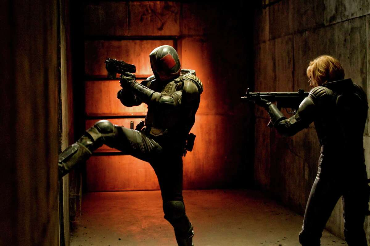 Judge Dredd (Karl Urban, left) and Anderson (Olivia Thirlby) star in