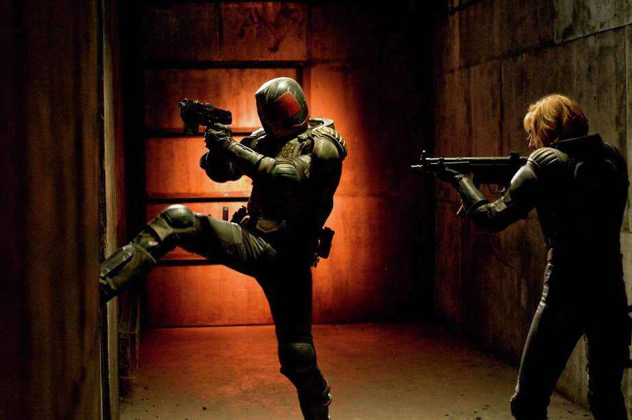 "Judge Dredd (Karl Urban, left) and Anderson (Olivia Thirlby) star in ""Dredd 3D."" (Courtesy Joe Alblas/MCT) Photo: HANDOUT, McClatchy-Tribune News Service / MCT"