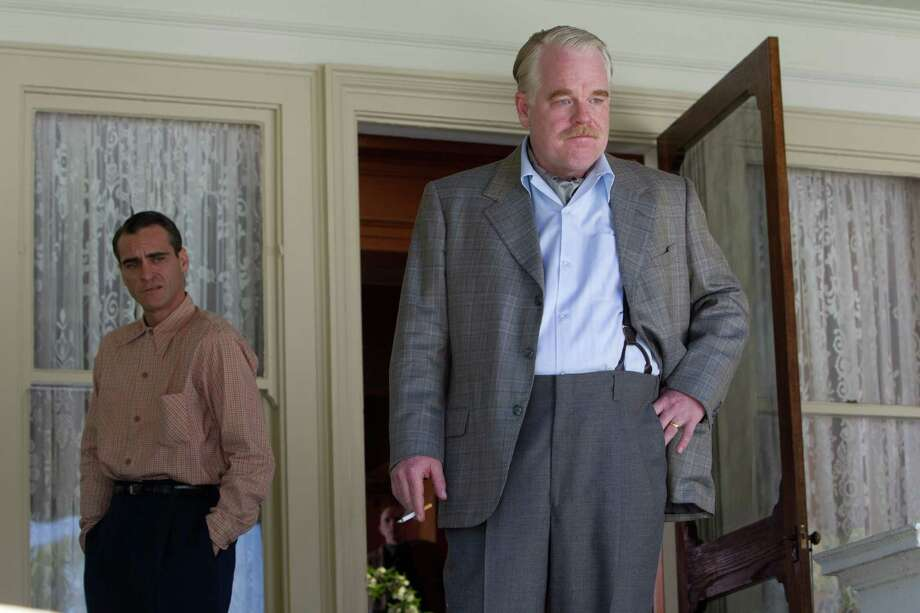"This film image released by The Weinstein Company shows Joaquin Phoenix, left, and Philip Seymour Hoffman in a scene from ""The Master.""  The film will be presented at the 37th Toronto International Film festival running through Sept. 16. (AP Photo/The Weinstein Company) Photo: Associated Press / The Weinstein Company"
