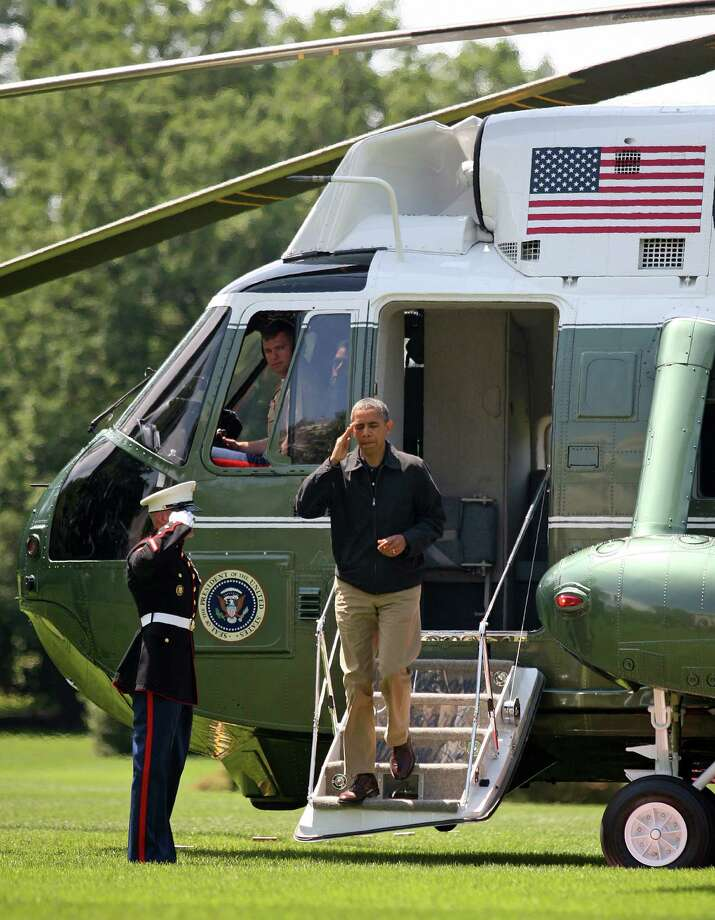 U.S. President Barack Obama salutes as he disembarks the Marine One on the South Lawn of the White House June 3, 2012 in Washington, DC. Sikorsky, which makes the helicopter shown, faces a new challenge for the government contract from AgustaWestland. Photo: Pool, Getty Images / 2012 Getty Images