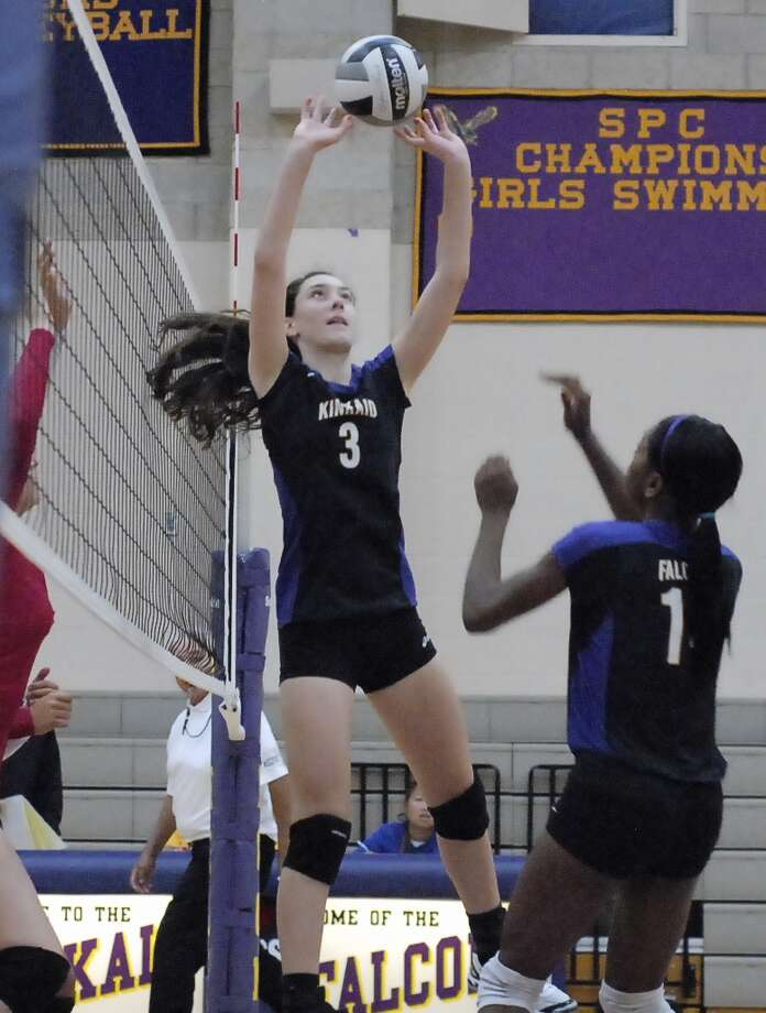 Kinkaid's Frances Andrews sets the ball up at the net during their game with Pope John XXIII earlier this season. Photo:  Tony Bullard 2012 / © Tony Bullard & the Houston Chronicle