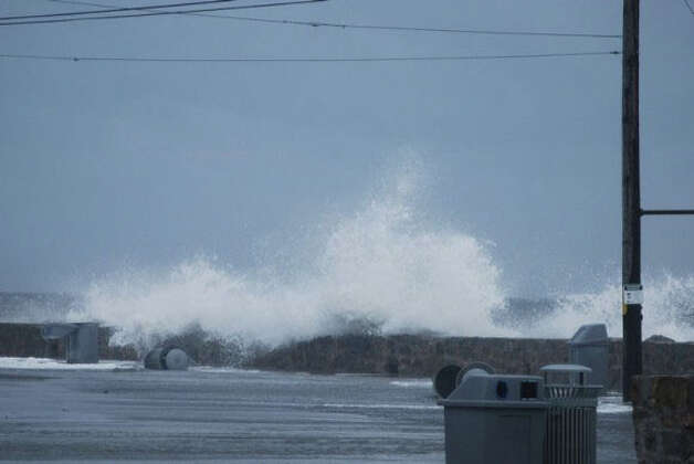 Waves crash in Lordship in Stratford, Conn. during a strong storm on Tuesday, Sept. 18, 2012. WTNH ReportIt photo by Karen Biebel-Sutera. Photo: Contributed