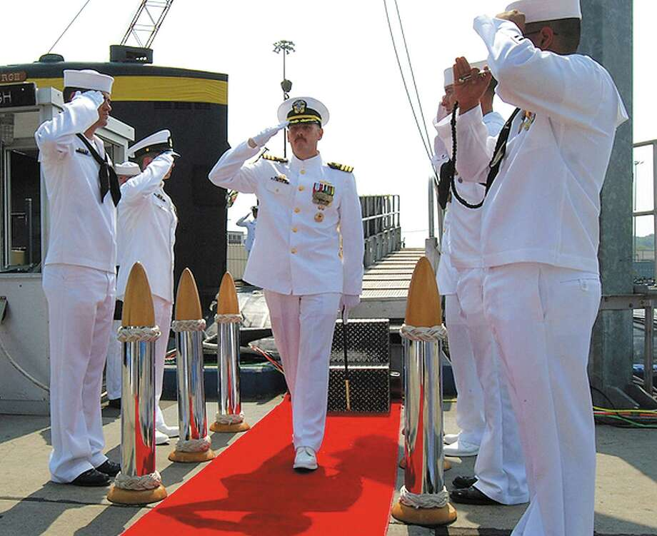 SUBMARINE COMMANDER DISMISSEDFor tabloid drama, nothing in 2012 topped the saga of a Navy officer who was dismissed as commander of a Groton-based submarine after faking his own death to end an affair with a girlfriend. Navy Cmdr. Michael P. Ward II was relieved of his duties aboard the USS Pittsburgh on Aug. 10, a week after taking command of the submarine. The investigation into his conduct began when a relative of Ward's mistress contacted the Naval Criminal Investigative Service. Photo: Jason J. Perry / U.S. Navy via The Day of New Lon