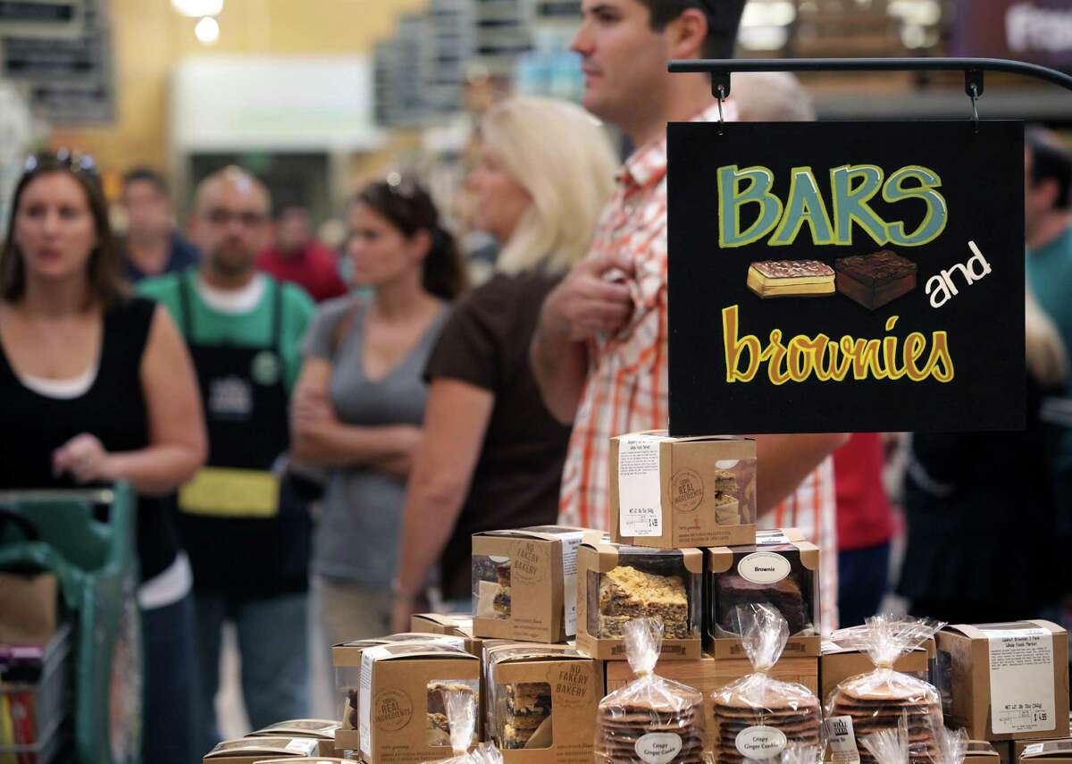 Customers at the new Whole Foods Market strole past a display of Bars and Brownies, during the grand opening at 18403 Blanco, Tuesday, Sept. 18, 2012.