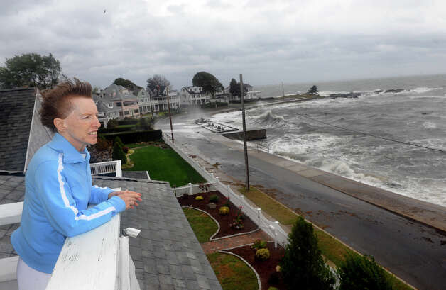 Lesley Mills looks out at the Long Island Sound from the third floor deck at her home along Beach Avenue in the Woodmont section of Milford, Conn. on Tuesday September 18, 2012. Photo: Christian Abraham / Connecticut Post