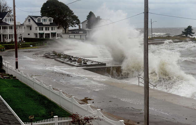 Waves from the Long Island Sound crash into the sea wall along Beach Avenue in the Woodmont section of Milford, Conn. on Tuesday September 18, 2012. Photo: Christian Abraham / Connecticut Post