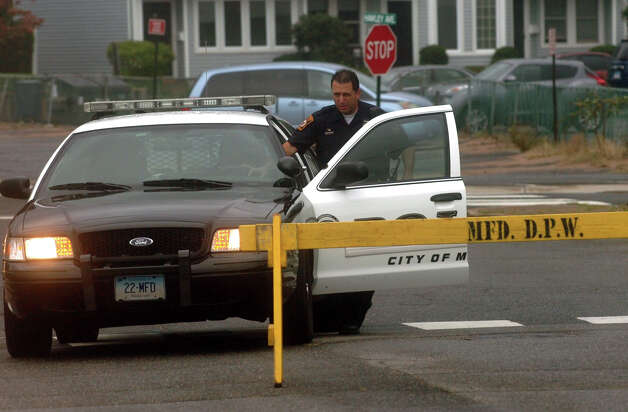 A Milford Police Officer is stationed along a closed Beach Avenue in the Woodmont section of Milford, Conn. on Tuesday September 18, 2012. Photo: Christian Abraham / Connecticut Post