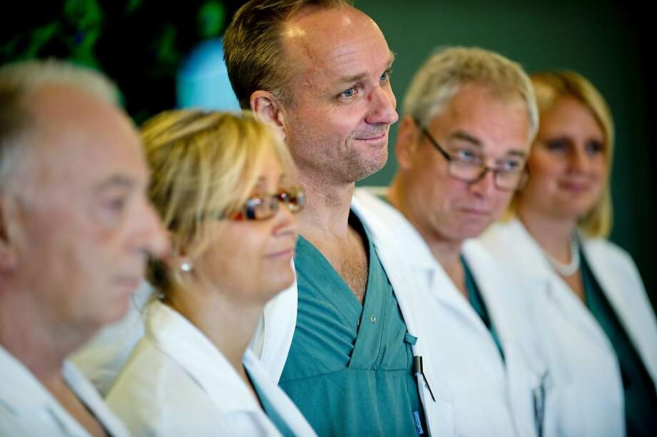 From left specialist surgeons Andreas G Tzakis, Pernilla Dahm-Kähler, Mats Brannstrom, Michael Olausson and Liza Johannesson attend a news conference Tuesday Sept. 18, 2012 at Sahlgrenska hospital in Goteborg Sweden. Two Swedish women are carrying the wombs of their mothers after what doctors called the world's first mother-to-daughter uterus transplants.  The specialists at the University of Goteborg completed the surgery over the weekend without complications, but say they won't consider the procedures successful unless the women achieve pregnancy after their observation period ends a year from now.  (AP Photo/Adam Ihse) SWEDEN OUT Photo: Adam Ihse, Associated Press