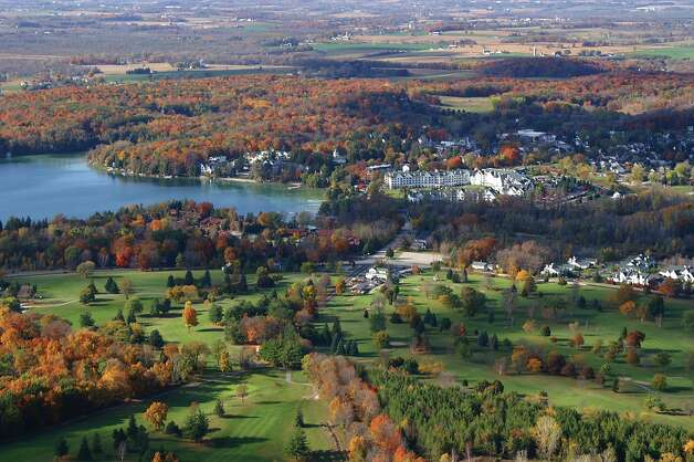 An aerial view of Elkhart Lake reveals its range of fall colors. Image credit Elkhart Lake Tourism