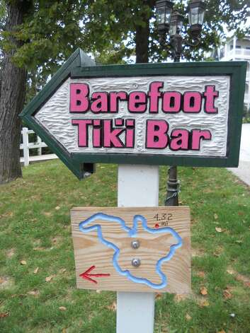 Carved wood signs appear along Elkhart Lake's walking path show where you are on the path. Image credit Robin Soslow