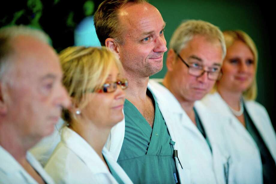 From left specialist surgeons Andreas G Tzakis, Pernilla Dahm-Kähler, Mats Brannstrom, Michael Olausson and Liza Johannesson attend a news conference Tuesday Sept. 18, 2012 at Sahlgrenska hospital in Goteborg Sweden. Two Swedish women are carrying the wombs of their mothers after what doctors called the world's first mother-to-daughter uterus transplants.  The specialists at the University of Goteborg completed the surgery over the weekend without complications, but say they won't consider the procedures successful unless the women achieve pregnancy after their observation period ends a year from now.  (AP Photo/Adam Ihse) SWEDEN OUT Photo: ADAM IHSE, Associated Press / SCANPIX SWEDEN