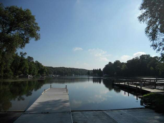 A boat launch on the edge of Elkhart Lake. Formed by glaciers, the crystal clear lake attracts boaters most of the year. Image credit Robin Soslow