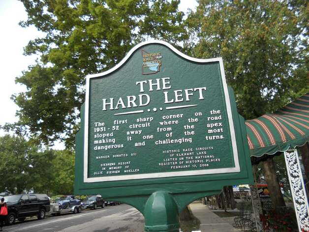 "This historical marker for ""The Hard Left"" commemorates a sharp turn on Elkhart Lake's 1951-1952 open road racing circuit. It's near the historic Siebkens Resort. Image credit Robin Soslow"