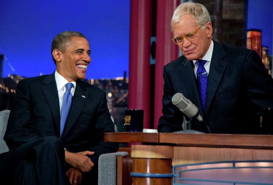 "President Barack Obama talks with David Letterman on the set of the ""Late Show With David Letterman"" at the Ed Sullivan Theater, Tuesday, Sept. 18, 2012, in New York.  The president did know the amount of the national debt. Photo: Carolyn Kaster, Associated Press / AP"