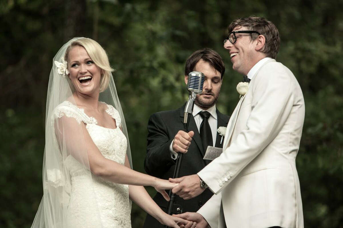 This Saturday, Sept. 15, 2012 photo released by Joshua Black Wilkins shows Patrick Carney of The Black Keys, right, with his bride Emily Ward at their wedding officiated by actor Will Forte, center, at the couple's home in Nashville, Tenn. The Keys' publicist says the couple was joined by about 350 family and friends for the back-yard ceremony. Comedian Will Forte officiated the wedding. Ward wore a dress by Carolina Herrera and walked down the aisle to