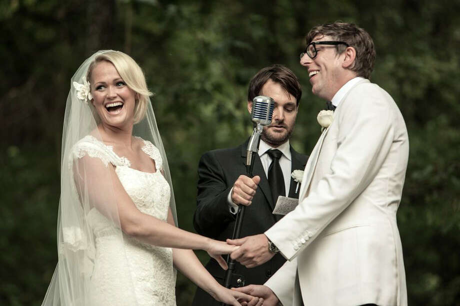 """This Saturday, Sept. 15, 2012 photo released by Joshua Black Wilkins shows Patrick Carney of The Black Keys, right, with his bride Emily Ward at their wedding officiated by actor Will Forte, center, at the couple's home in Nashville, Tenn.  The Keys' publicist says the couple was joined by about 350 family and friends for the back-yard ceremony. Comedian Will Forte officiated the wedding. Ward wore a dress by Carolina Herrera and walked down the aisle to """"Crimson and Clover"""" by Tommy James & The Shondells. (AP Photo/Joshua Black Wilkins) Photo: Joshua Black Wilkins, Associated Press / Joshua Black Wilkins"""