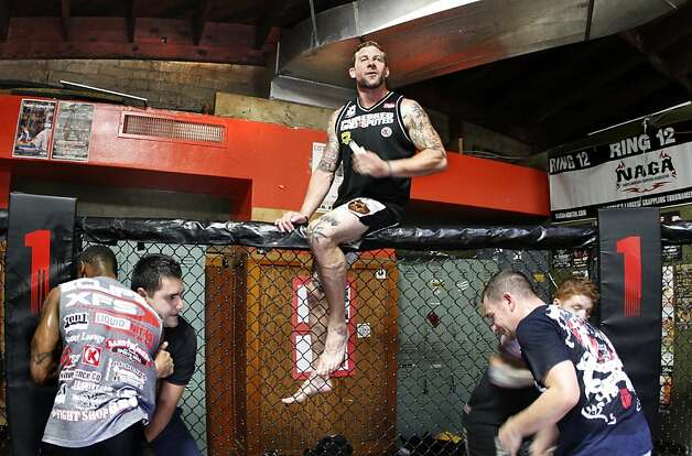 Iraq war veteran Todd Vance, a mixed martial-arts expert, drills fellow vets at a gym in San Diego. Photo: Don Bartletti, McClatchy-Tribune News Service