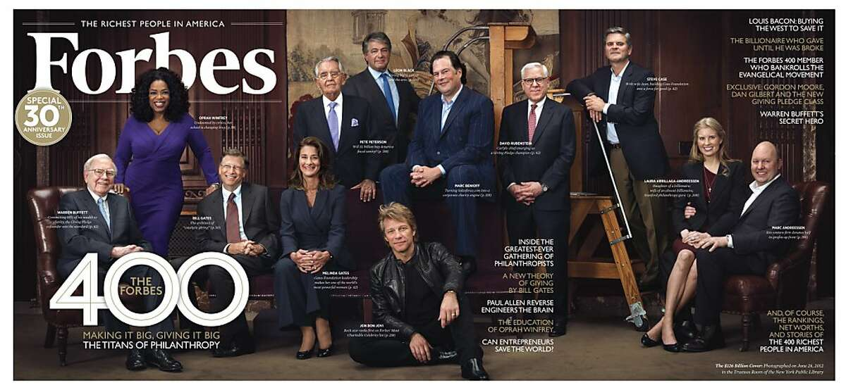 This June 26, 2012 image provided by Forbes, and the pull-out cover for the magazine's Sept. 21 issue shows from left to right: Warren Buffett, Oprah Winfrey, Bill Gates, Melinda Gates, Pete Petersen, Leon Black, Jon Bon Jovi (seated on the ground), Marc Benioff, David Rubenstein, Steve Case, Laura Arrillaga-Andreessen, Marc Andreessen posing for a portrait in the Trustees Room at the New York Public Library in New York. The twelve individuals shown were part of a group attending a Forbes convened event called the Forbes 400 Summit On Philanthropy. During the event, the magazine's editors invited twelve of the leading philanthropists in the U.S. to pose for the portrait.