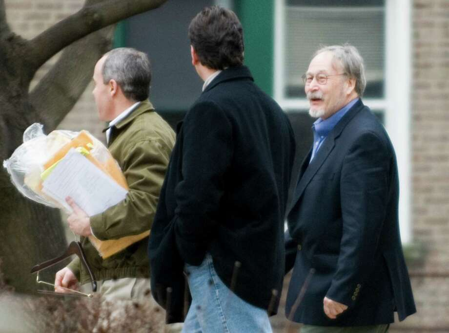 Bridgeport_012207_ Robert Tate, 64, of Greenwich, right, leaves U.S. District Court in Bridgeport, Conn. after pleading guilty to possession of child pornography on Monday, Jan. 22, 2007. Chris Preovolos/Staff photo Photo: CHRIS PREOVOLOS, ST / Stamford Advocate