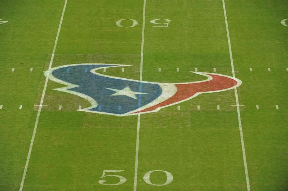 Texans games will remain on a grass turf, but high school and college football games will be played on a different surface. (AP Photo/Dave Einsel) Photo: Dave Einsel, Associated Press / FR43584 AP