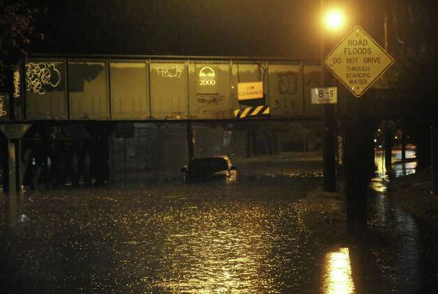 A vehicle sits stranded on a flooded Weaver Street in Schenectady, NY Tuesday Sept. 18, 2012. (Michael P. Farrell/Times Union) Photo: Michael P. Farrell
