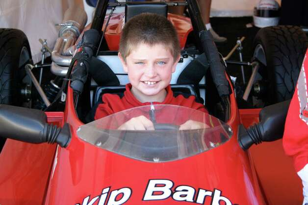Ben Albano, at age 9, sits in a Skip Barber racecar for the first time at Limerock Park in Lakeville, CT. It wouldn't be the last time. Photo: Contributed Photo