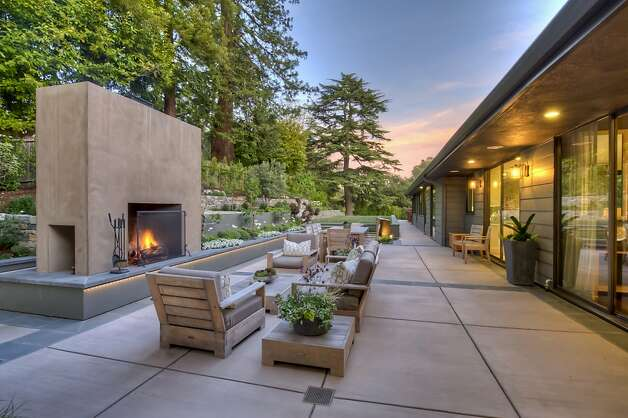 Architect April Gruber designed an outdoor living room with a statement-making hearth.   Residental landscape design Photo: Treve Johnson Photography
