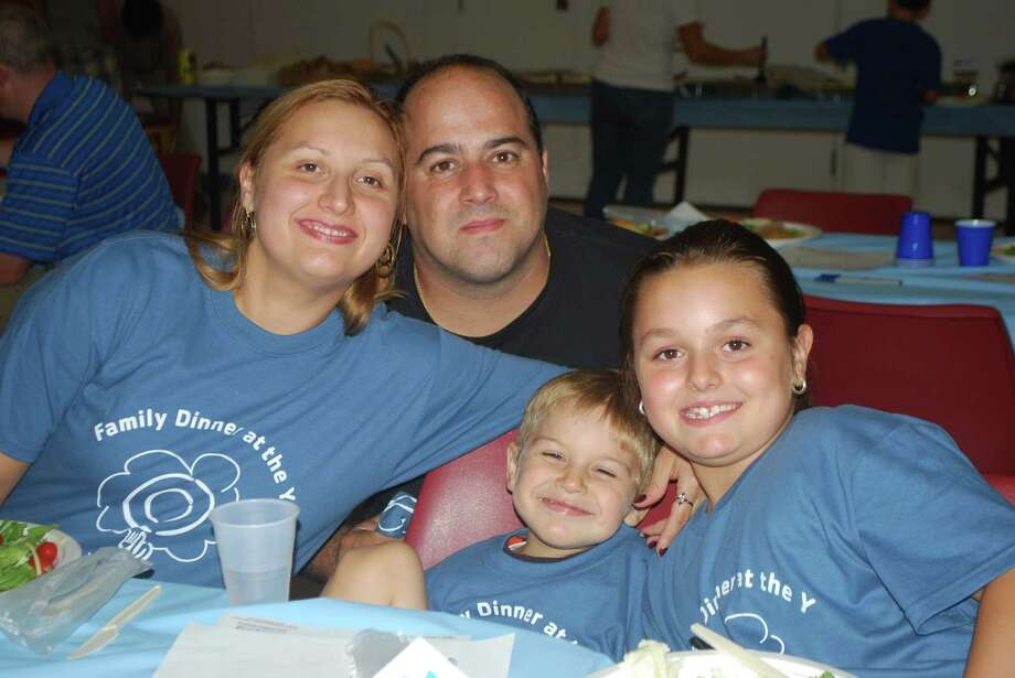 The Bender family relaxes at last year's Y Family Dinner Night. This year's event is Friday, Sept. 28, from 6 to 8 p.m. Photo: Contributed Photo
