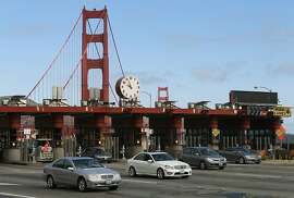 Commuters drive through the Golden Gate Bridge toll plaza in San Francisco, Calif. on Tuesday, Sept. 18, 2012. Bridge district officials outlined plans for the upcoming transition to an all-automated toll collection system.