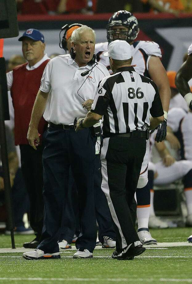 The Broncos' John Fox joins the chorus of NFL coaches and players upset with the officiating. Photo: David Goldman / AP