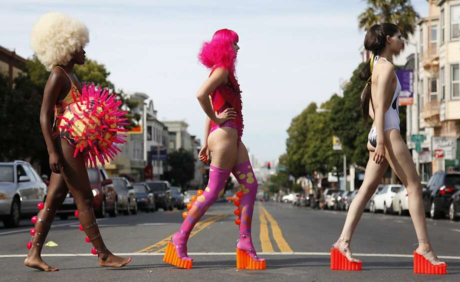 "Jamila Ekukpe, Raven Le Faye and Gaby Lerma strut across Valencia Street during a ""fash mob"" organized by avant-garde fashion designer Ilanio to debut his spring and summer 2013 collection in San Francisco Calif. on Sunday, Sept. 16, 2012. The sky-high shoes the models wore were problematic structurally and many came apart during the show. Photo: Alex Washburn, Special To The Chronicle"
