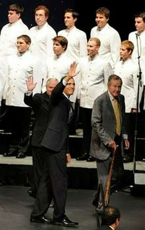 President Barack Obama, center, former President George H. W. Bush, right, and Defense Secretary Robert Gates say goodbye to the crowd at Texas A&M University where they spoke on occasion of the 20th anniversary of the Points of Light community service movement Friday, Oct. 16, 2009, in College Station, Texas. Photo: Pat Sullivan, AP / AP