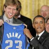 Dirk Nowitzki presents a World Champion Mavs' uniform to President Obama.