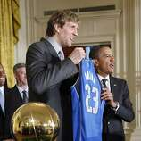 President Obama with the NBA championship trophy won in 2011 by the Dallas Mavericks.