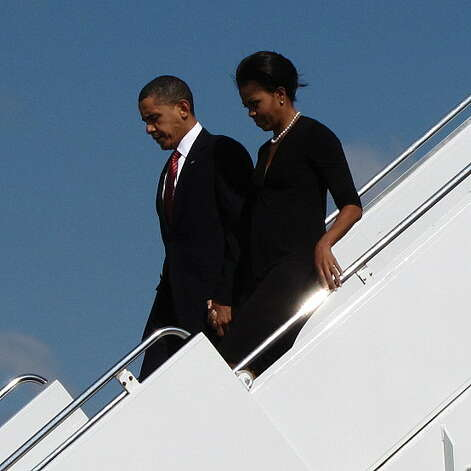 President Barack Obama and first lady Michelle Obama arrive at Robert Gray Army Air Field in Killeen, Texas, Tuesday, Nov. 10, 2009. Obama traveled to Fort Hood, Texas to meet with families of the those wounded and killed in last week's shooting. Photo: Picasa 3.0