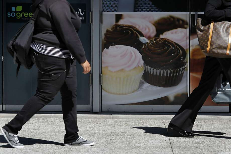 Pedestrians walk past the Metreon center in San Francisco. California is currently the 46th-fattest state. Photo: Paul Chinn, The Chronicle