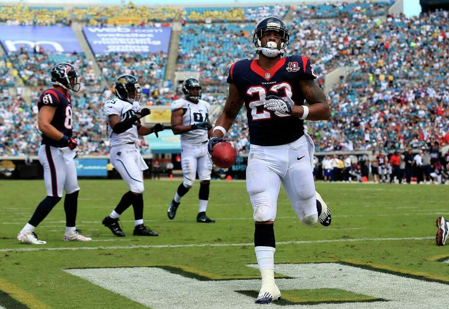 Running back Arian Foster, scoring a touchdown at Jacksonville, and the Texans will have a tougher test Sunday in Denver against Peyton Manning and the Broncos. Photo: Sam Greenwood, Getty Images / 2012 Getty Images