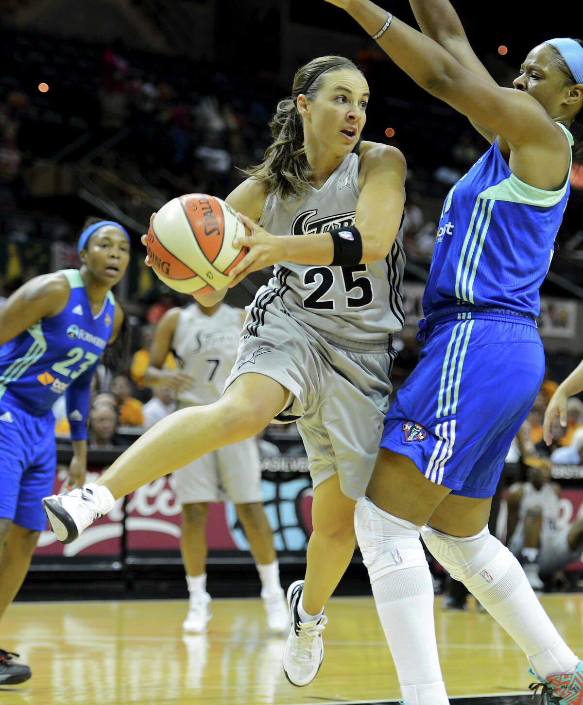 Guard Becky Hammon looks to pass around the New York Liberty's Kia Vaughn during Tuesday night's 77-66 Silver Stars victory at the AT&T Center. A 22-9 fourth quarter fueled the win.